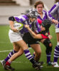 A K-State Women's Rugby player runs with a Oklahoma player hanging off her at Memorial Stadium on Sept. 15, 2012.
