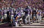 Junior offensive lineman Tavon Rooks takes a knee before a game at Bill Snyder Family Stadium in 2012.