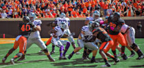 Kansas State sophomore quarterback Daniel Sams finding the seam opened up by his offensive line against the Oklahoma State defense Oct. 5, 2013