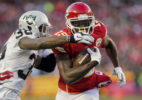 Kansas City Chiefs wide receiver Jeremy Maclin (19) takes off after a catch before Oakland Raider cornerback TJ Carrie (38) tackles him at Arrowhead Stadium on January 3, 2015.